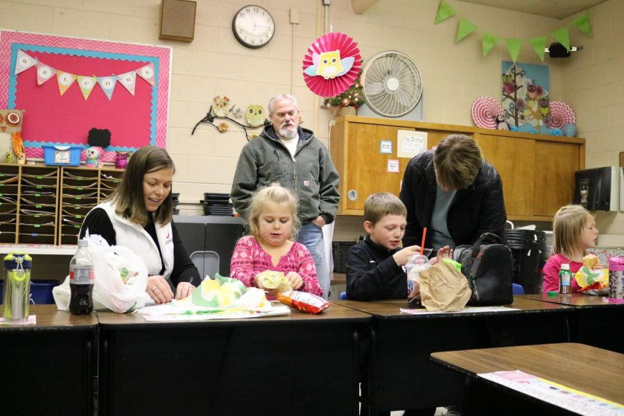 Elementary students share lunch with those they love most